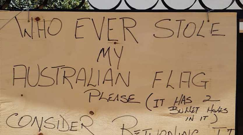 The sign begged for the return of the flag. Picture: Meanwhile in Australia/Facebook