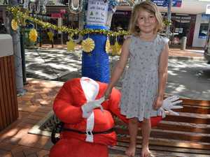 Six year-old Juna Weiss with the headless Santa Claus