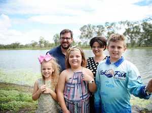 Nicholas Thompson with his parents Matt and Samara