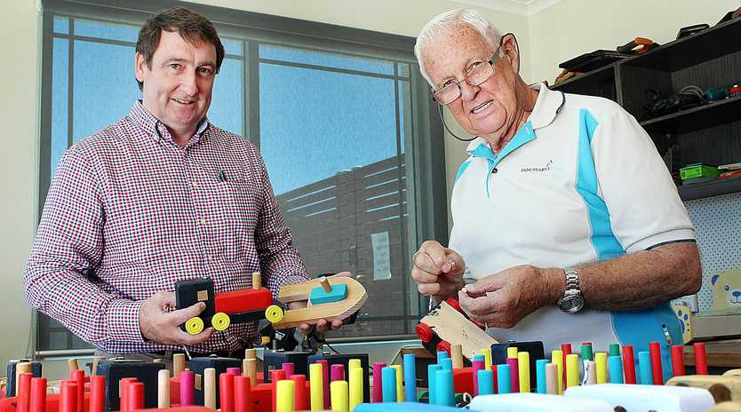 SANTA'S WORKSHOP: Win Projects managing director Glen Winney and The Waterford Men's Shed volunteer Glenn Parmenter with some of the toys that will be donated to underprivileged children this Christmas.