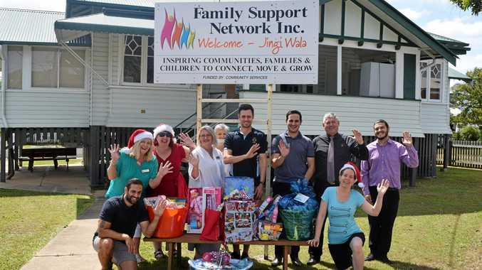 HELPING FAMILIES: Family Support Network's staff and volunteers alongside Adopt A Family sponsors, including Summerland Credit Union, Rooftech and Novaskill.
