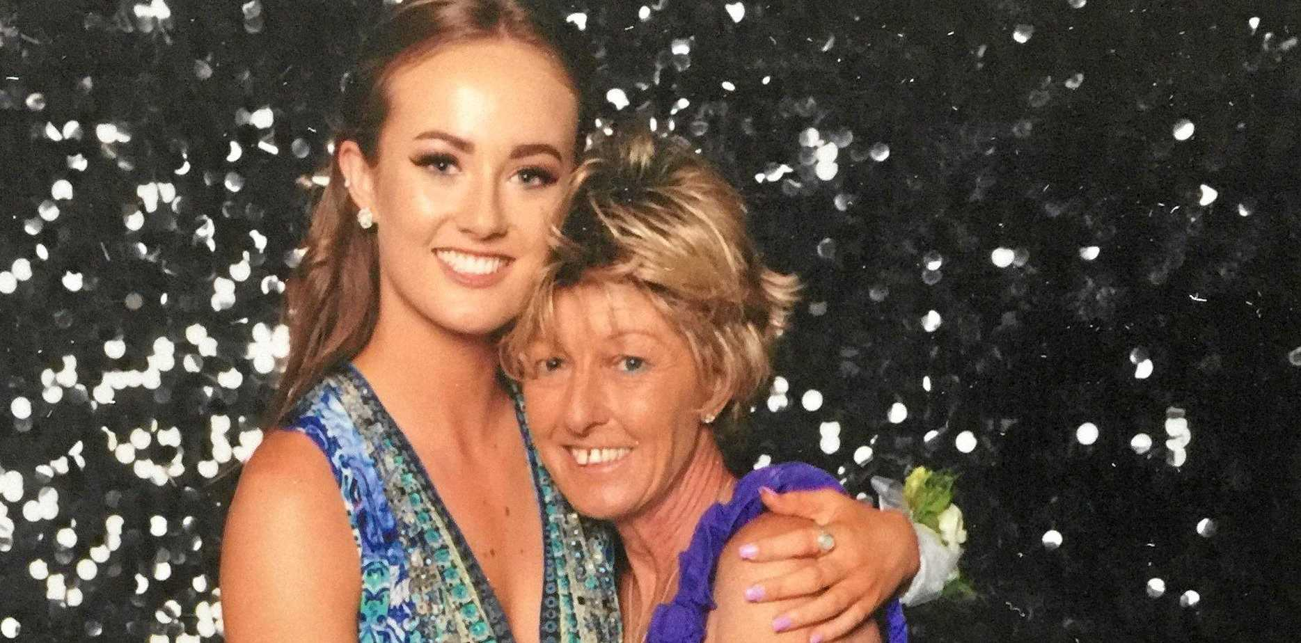 BONDS: Jesse Moss with her mum Peta who died of cancer last year. Peta wears a wig she loved after losing her hair from chemotherapy.