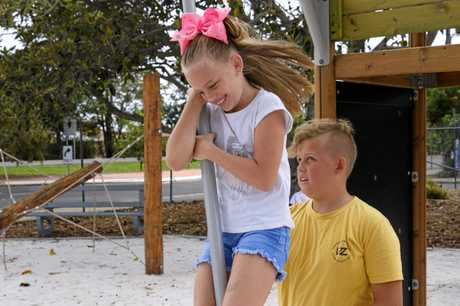 BROTHERLY LOVE: Ethan Togo, 12, spins his sister Zahli, 9, at the new Botanic Gardens play ground in North Bundaberg.