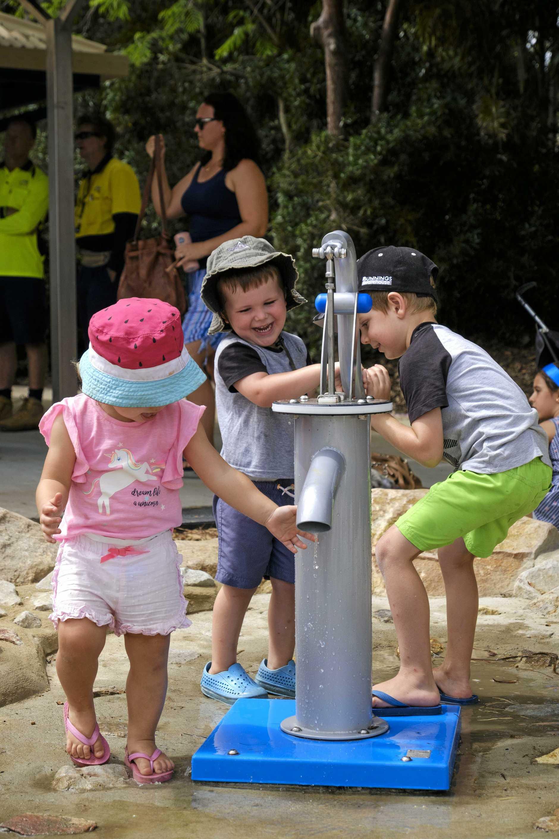 SPLASH: Addison Dick, 1, Ben Freeman, 3, and Dexter Lee, 5, play with the water pump at the new Botanic Gardens playground in North Bundaberg.