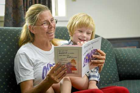 Katherine Scriffingnano reads Monster, a book which she illustrated, to son Tyler.