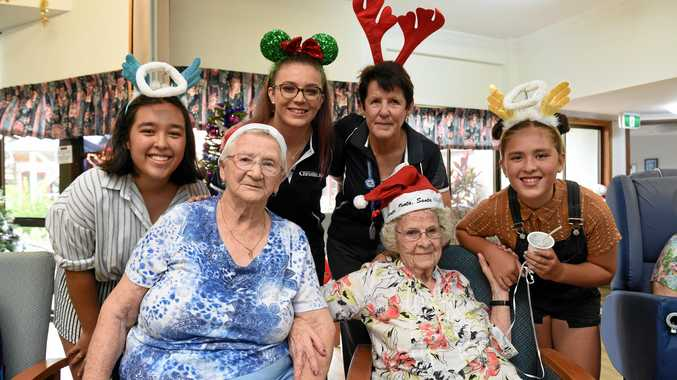 SPREADING GOOD CHEER: Fraser Coast Chronicle staff and family spread the Christmas spirit to residents at Masters Lodge in Hervey Bay. Residents Elsie Taylor and Therese Cunneen with, left, An Butler, Jessica Cook, Vicki Seddon and Livi Butler.