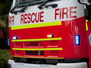 Fire burns at Brisbane scrap metal yard