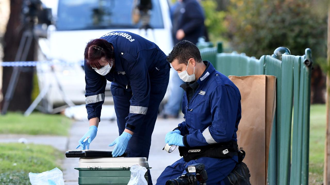 Victoria police forensics examine the area where Paul Costa was found murdered. Picture: Joe Castro/AAP