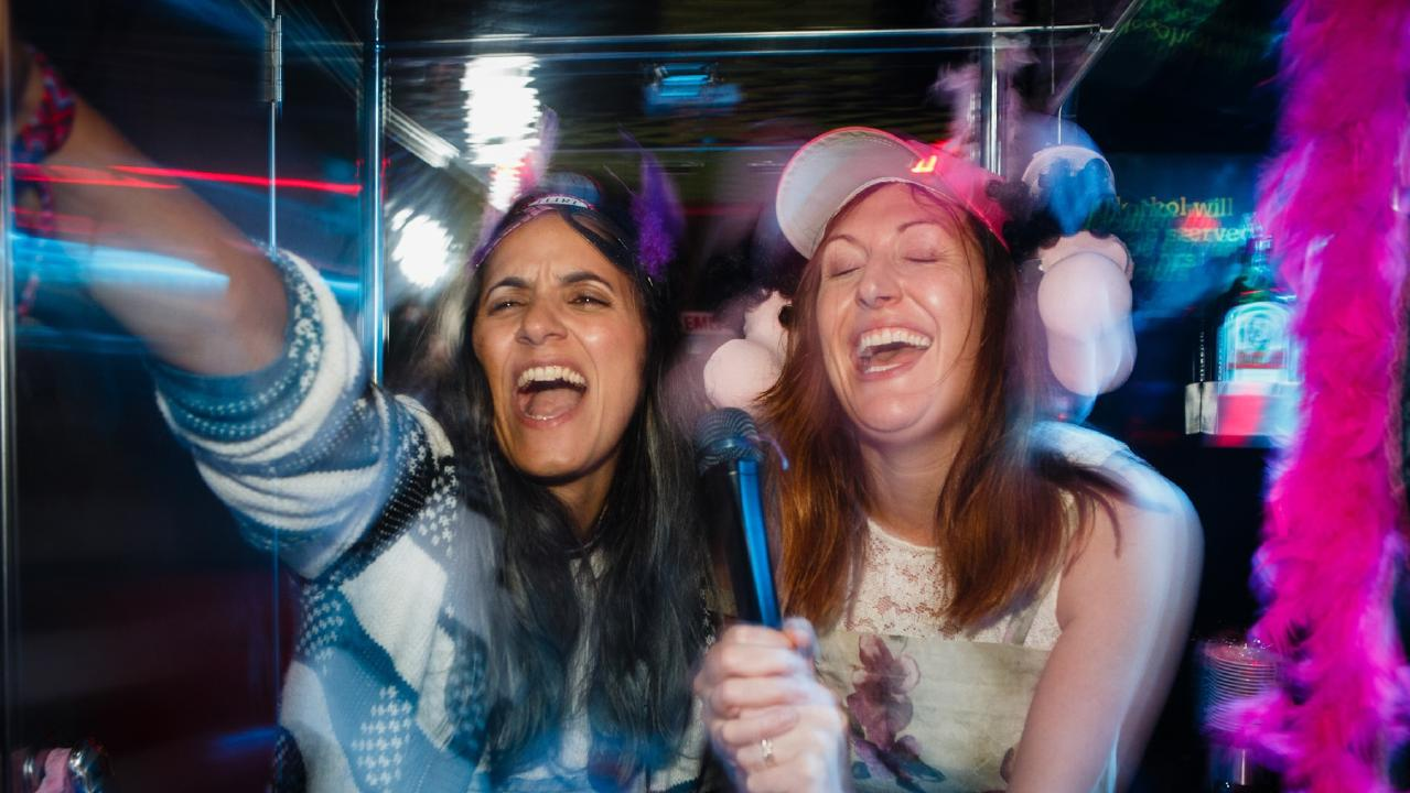 Madeleine Sami and Celia Pacquola on a karaoke party bus in a scene from The Breaker Upperers.
