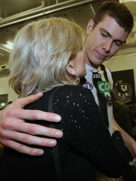 Mason Cox with his mum in the Collingwood rooms. Picture: Alex Coppel