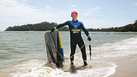 FILE PHOTO: Lifeguard Matt Sinclair dons a range of protective safety clothing before doing a sweep of the Kewarra Beach netted swimming enclosure for any marine stingers. Picture: BRENDAN RADKE.