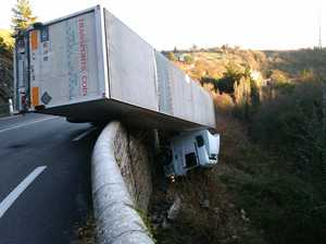Driver's miraculous escape from truck hanging off hillside