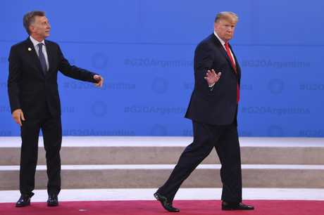 US President Donald Trump leaves Argentina President Mauricio Macri confused at the G20 summit in Buenos Aires in November, 2018.