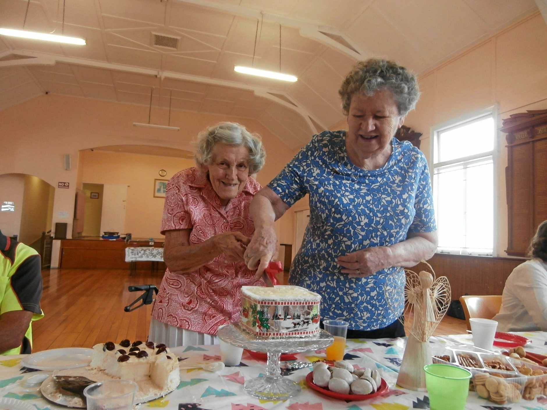Foundation members, Berenice Corvi and Margaret Morrow (club patron) cutting the Christmas Cake at the December meeting of the club.