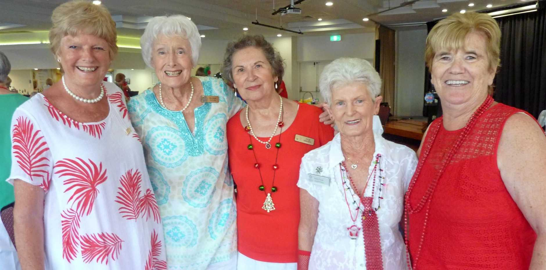 LOOKING FESTIVE: Laura Hall, Heather Taylor, Julie Geraghty, Nancy Stewart and Merle Rowe mix and mingle at the Caloundra Evening VIEW Dinner.