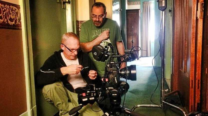 YOUR STORY: Coast OnScreen president Phil Moore, back, on the job making one of the collective's short films. Now he's showing Seniors how they can make their own films with basic skills and equipment.