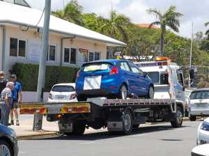 Car with political statements towed away from Gladstone shop
