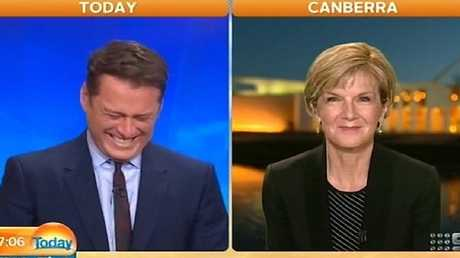 Karl cracking up with Julie Bishop on the telly. Picture: Supplied