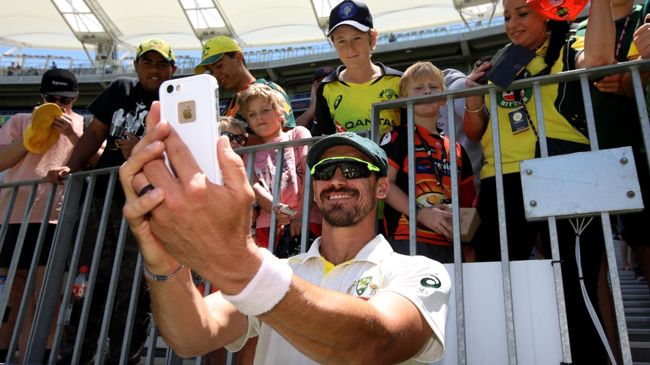 Mitchell Starc takes a selfie with fans after the second Test win. Picture: AAP
