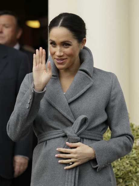 Meghan cradled her stomach while out and about in London. Picture: AP