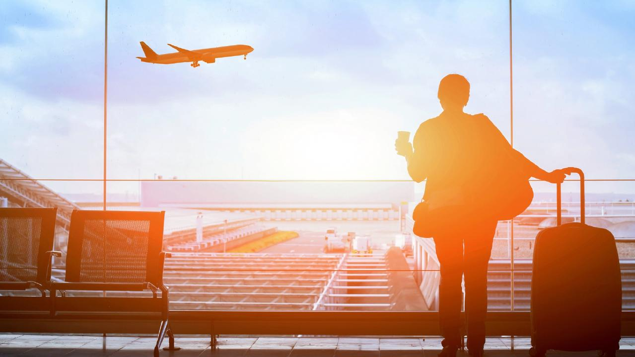 ESCAPE. FLYING HACKS. 23 SEPTEMBER 2018. happy traveler waiting for the flight in airport, departure terminal, immigration concept Picture: istock