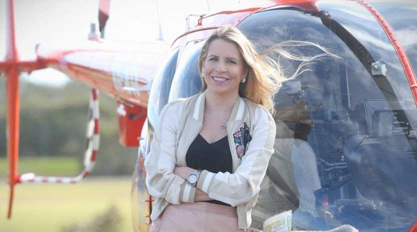# Sunday Mail # Olympia Kwitowski is the new helicopter traffic reporter for Brisbane. pics Jamie Hanson