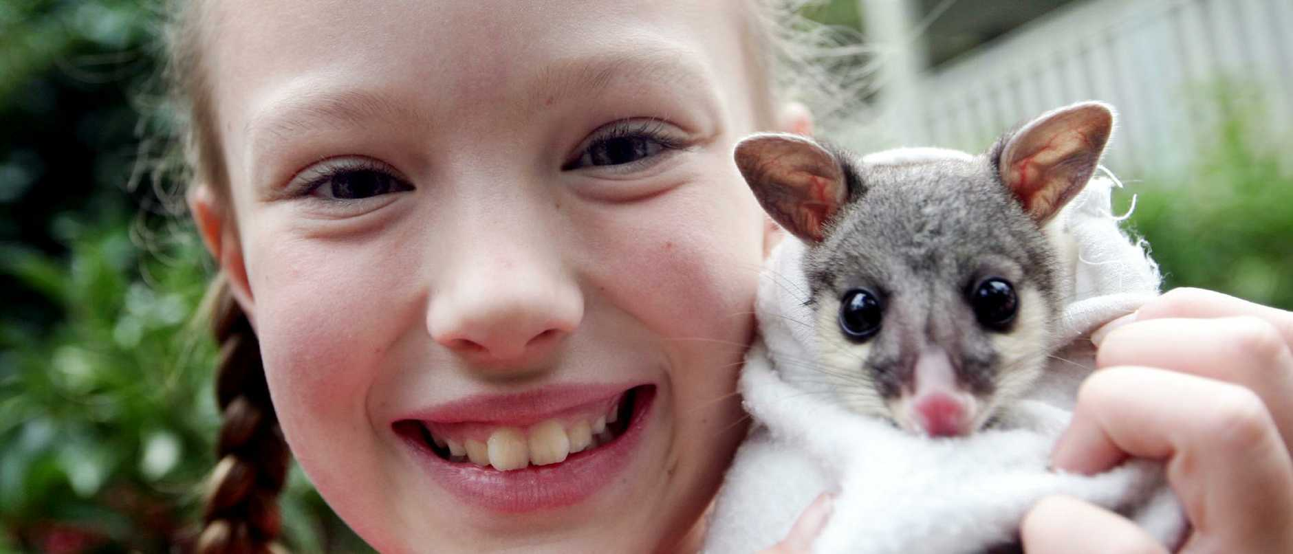 Jasmine Rasmussen had always had a passion for the environment, pictured at 10 years old with a 5-month-old brush tail possum.