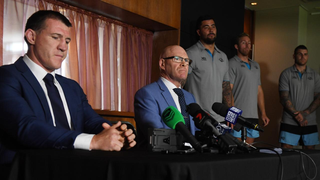 Sharks CEO Barry Russell and Sharks co-captain Paul Gallen are joined by senior players after the club was hit with heavy sanctions.