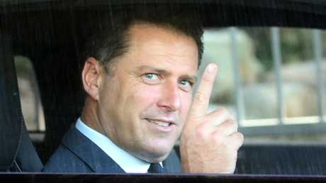 Karl all smiles as he leaves Channel 9 following Uber tape release. Picture: Diimex