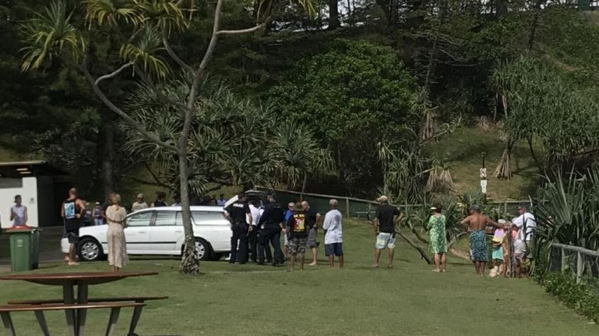 Family and friends of the surfer at the scene. Picture: Emily Halloran