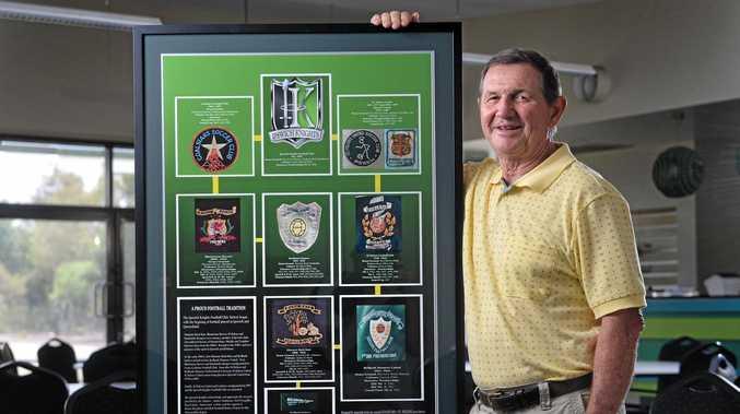 FANTASTIC LINK: Knights life member Ross Hallett has produced a special emblem memorabilia board commemorating the fascinating history of Ipswich soccer.
