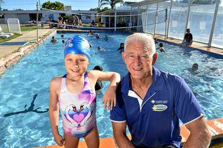 John Wallace has coached generations of families at the Caloundra Aquatic Lifestyle Centre. John is pictured with Isobel Anderson,7.