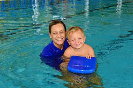 Kristy Perkins (with Zander Perkins) is passionate and serious about people learning how to swim.