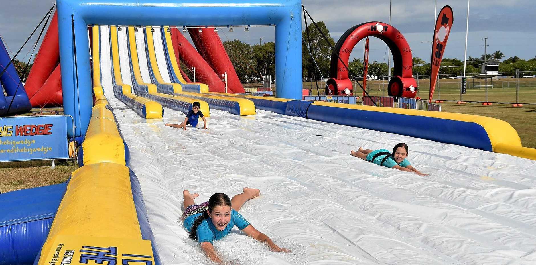 SLIDING FUN: The Big Wedgie has arrived at the Sunshine Coast Sports Precinct, Kawana, ready for the school holidays.