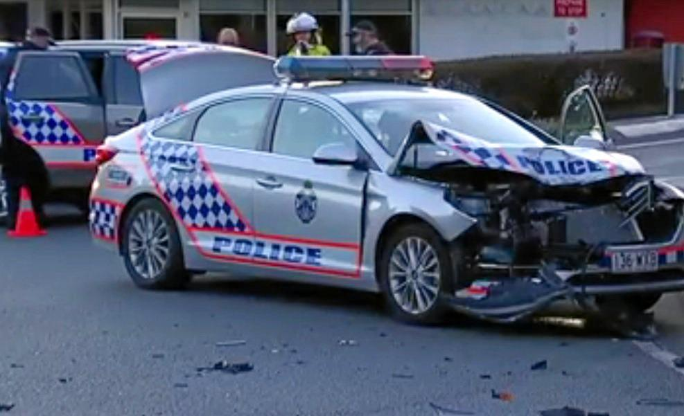 Two police officers were taken to hospital after an early morning chase ended in a collision at a Buderim roundabout.