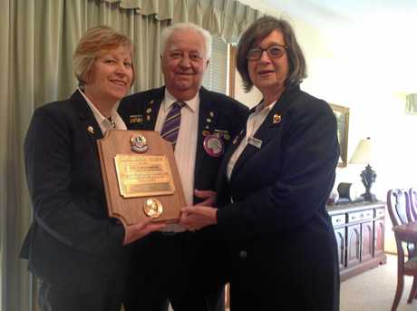 Laidley Lions Leanne Robinson and Barbara Matthews present Ray Bachmann with his Melvin Jones Fellowship, recognising his years of service to the Lions movement Photo Gary Worrall / Gatton Star