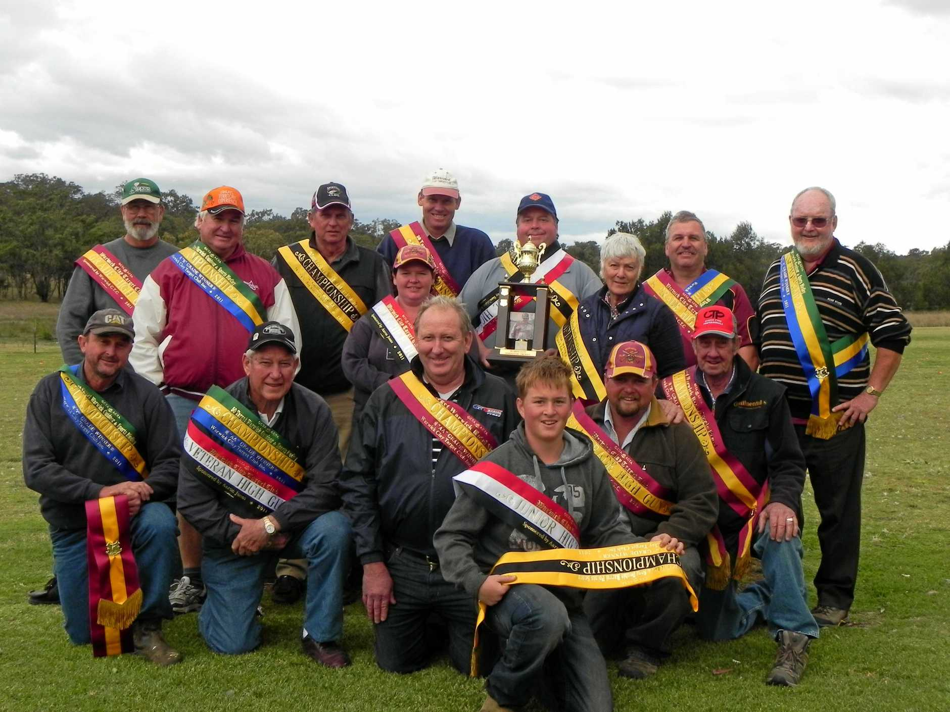 WINNERS: Warwick Clay Target Club annual shoot winners (standing, from left) Jim Hesbrook, Arthur Riley, Keith Simpson, Cameron Schoenfisch, Terry Rogers, Greg Smith, Terry Morony, (middle row) Kylie Green, Helen Finch, (kneeling) Bruce Pethers, Greg Newey, Paul Pearce, Michael Loy, Maurice Westbury and (front) Matthew Loy. Photo: Supplied by club