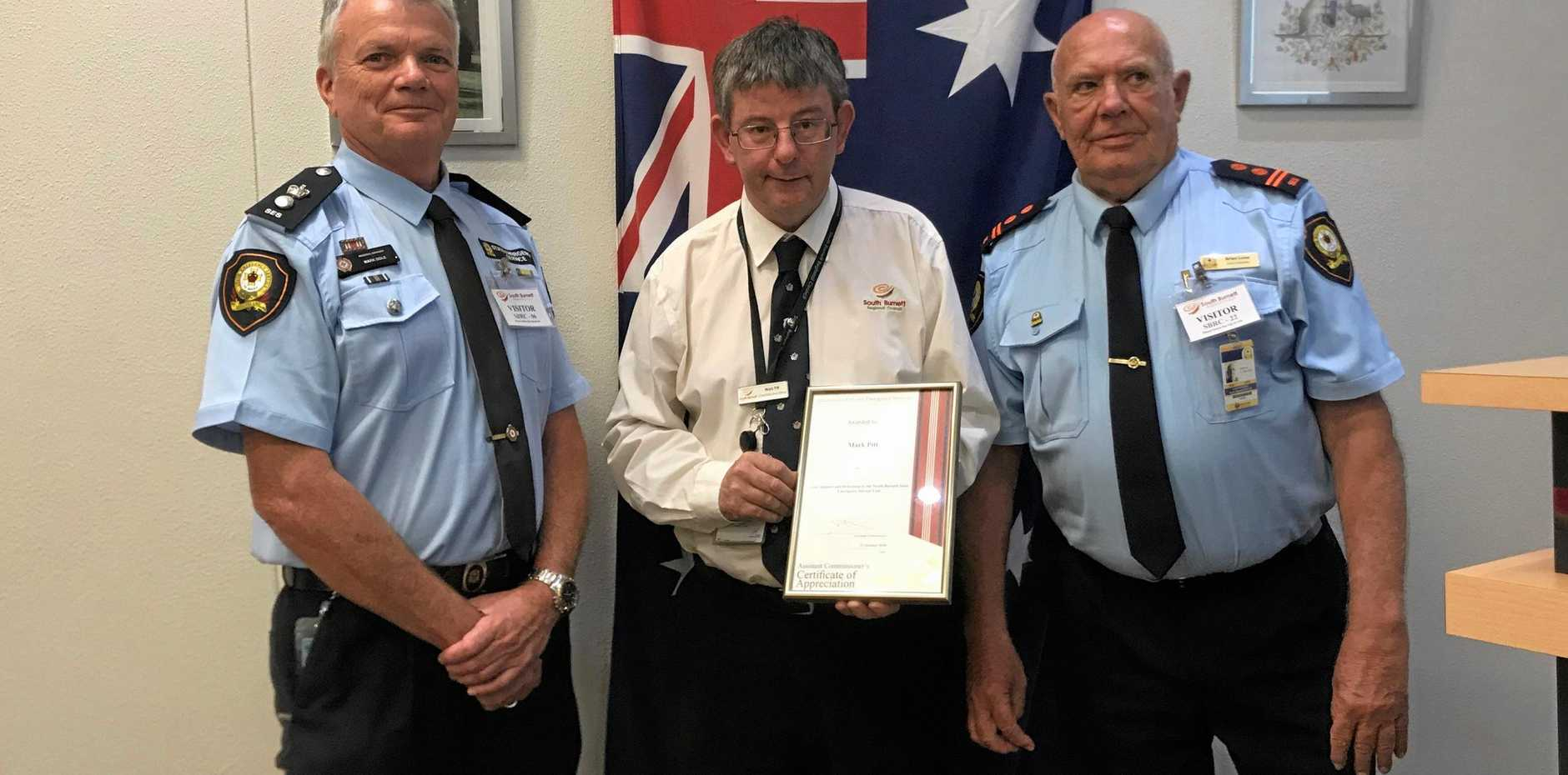 DISASTER MANAGEMENT: SES Brisbane Regional manager Mark Dole and North Burnett SES controller Brian Lowe thank South Burnett Regional Council CEO Mark Pitt for his dedication.