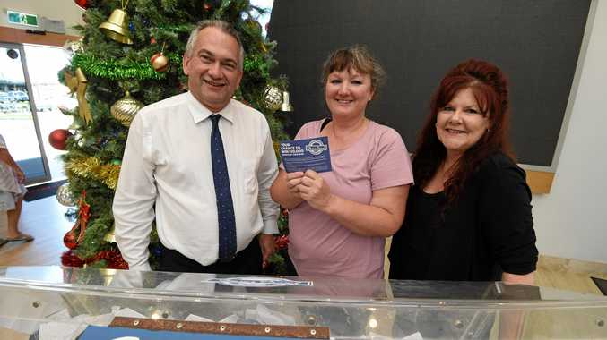 LUCKY LOCAL WINNER: Winner of the Fraser Proud promotion Amanda Harris from Torquay with Fraser Coast Chronicle general manager Brett Hanwright and Hervey Bay Chamber of Commerce president Sandra Holebrook.