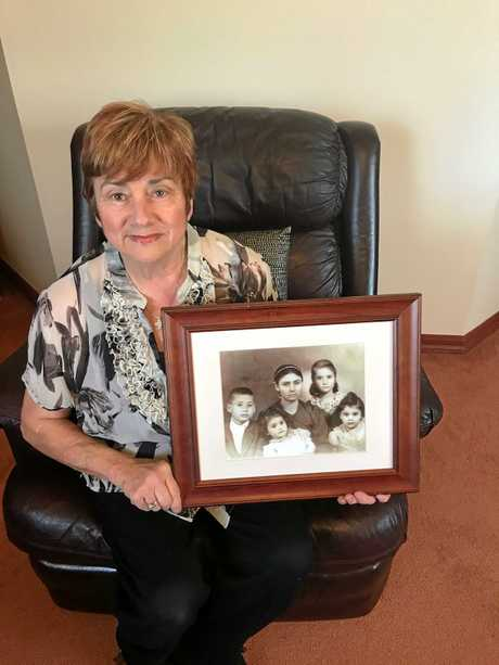 MEMORIES: Helen Perikkentis holds a photograph of her family she immigrated to Australia with in 1959.