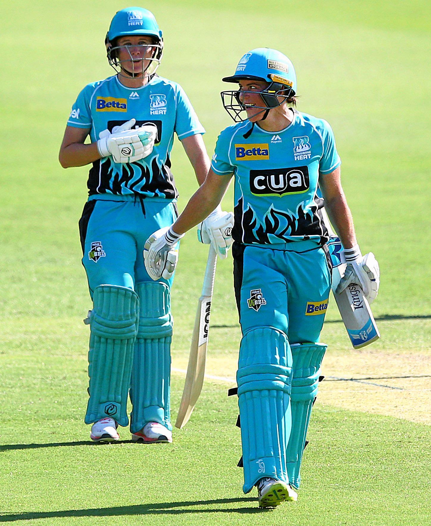 ON FIRE: Heat openers Beth Mooney and Grace Harris talk between overs during the Women's Big Bash League match against the Melbourne Stars at The Gabba.