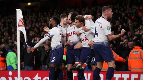 Dele Alli of Tottenham Hotspur celebrates with teammates after scoring his team's second goal