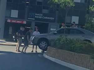 Car stranded on wall at shopping centre