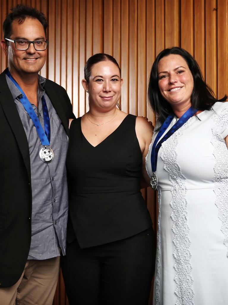 Danielle Dare, centre, with Darrin Collier and Lisa Elmas, the two motorists who pulled the Falkholt girls out of the car after it crashed. Picture: Tim Hunter.