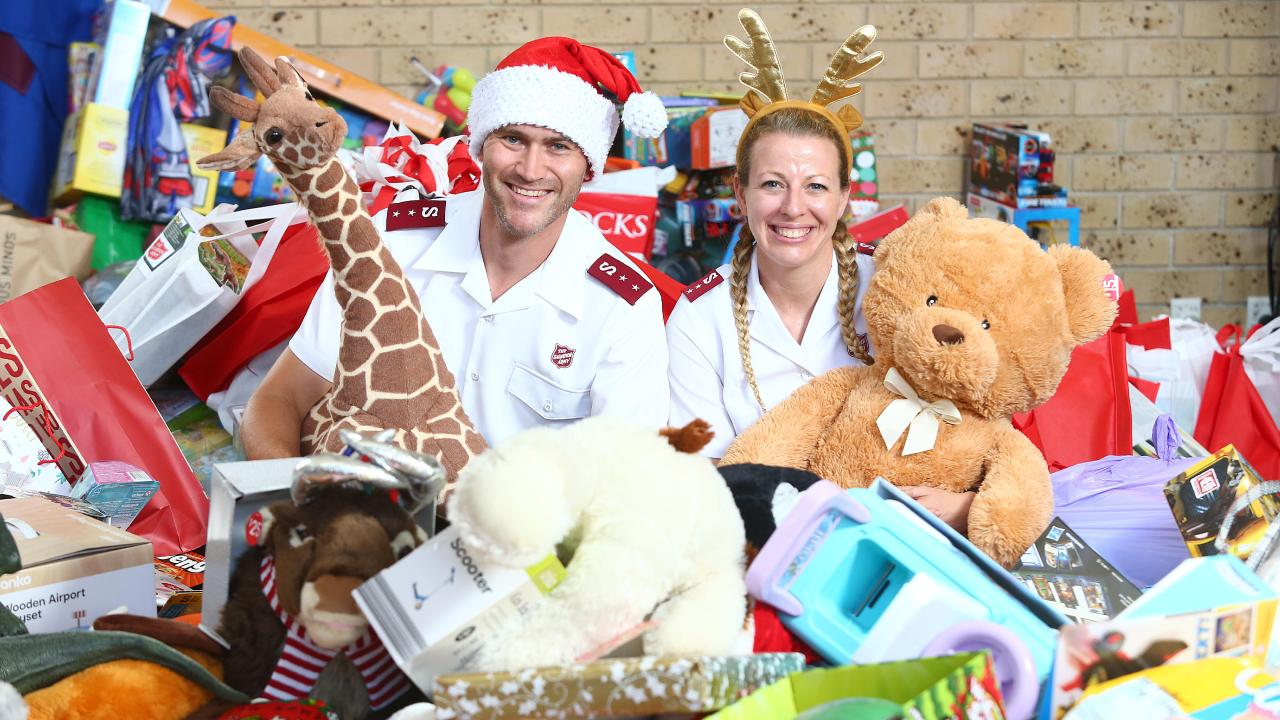Tim and Krista Andrews from the Salvation Army Carindale Corps are inundated with donations of toys to be packed and distributed to struggling families over Christmas. Picture: AAP/Jono Searle