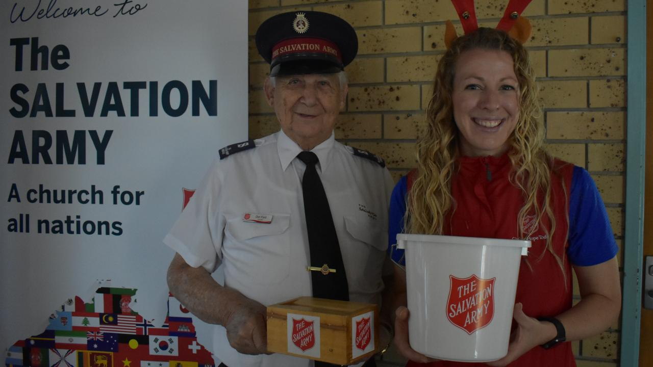 Salvation Army Carindale Corps soldier Don Ford and Captain Krista Andrews collect for their Christmas appeal. Picture: Brian Bennion