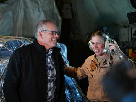 Australian Prime Minister Scott Morrison is seen on board an RAAF flight with Sgt Brodie Stewart during a visit to Baghdad Airbase in Iraq. Picture: AAP