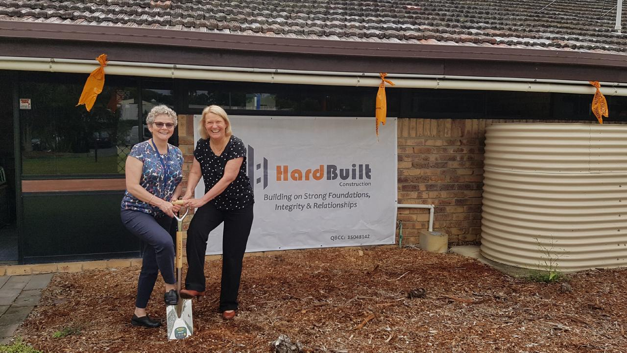 Principal of the Autism Queensland School Cae Ashton (left) and chief operations officer Pam Macrossan turn the first sod on the school's major redevelopment project.