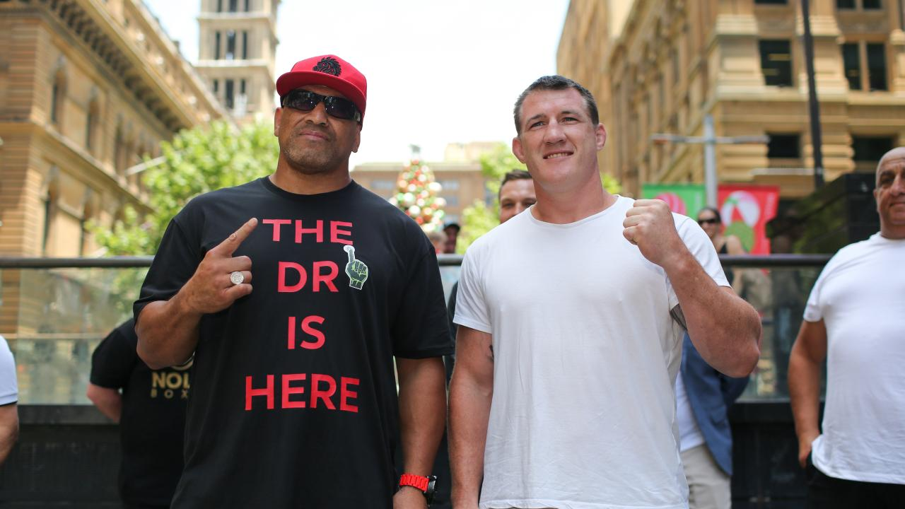 Cronulla Sharks NRL captain Paul Gallen (right) and former NRL player John Hopoate pose for photographs following a press conference at the Martin Place Amphitheatre in Sydney, Thursday, December 20, 2018. Paul Gallen announced former NRL player John Hopoate as his next boxing opponent. (AAP Image/Paul Braven) NO ARCHIVING