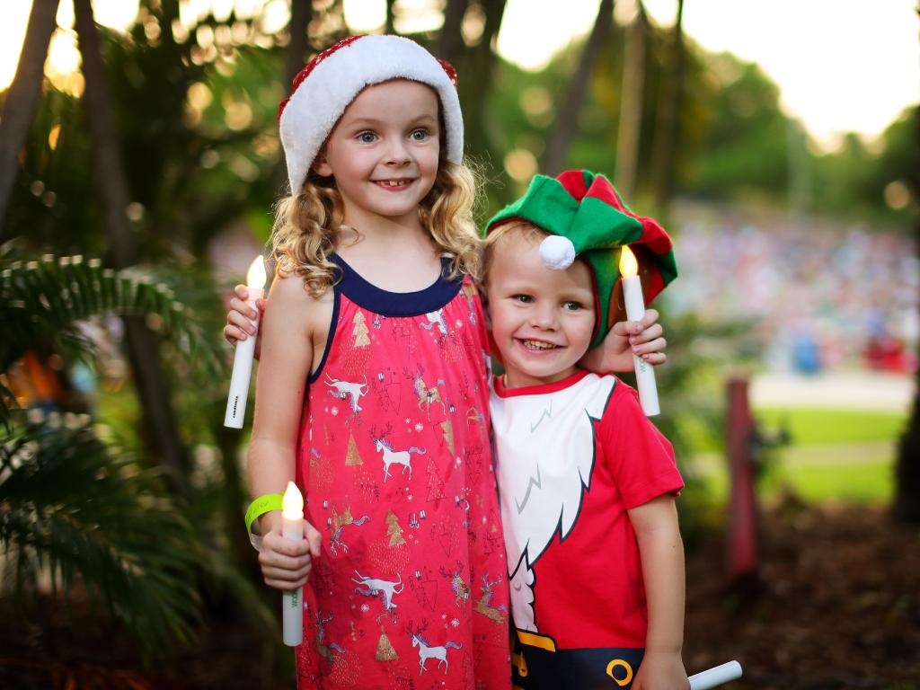 Siblings Jenna Mellon, 6, and Cooper Melon, 2, from Wulagi got in the Christmas spirit during the 43rd annual Carols by Candlelight at the Botanical Gardens Amphitheatre in Darwin. Picture: Justin Kennedy